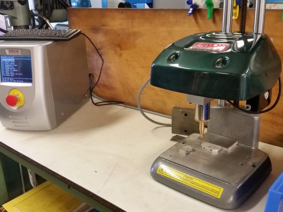 distribution-orientation machine à graver